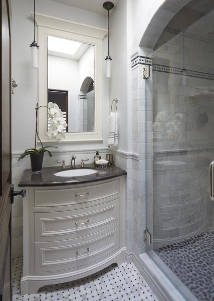 Modern home with bath room, marble counter, enclosed shower, porcelain tile floor, undermount sink, stone tile wall, recessed lighting, pendant lighting, and one piece toilet. Guest Bath Photo 19 of Rustic elegance