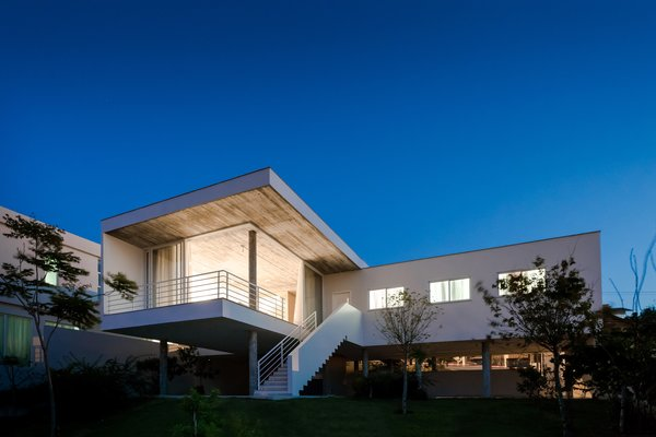 Modern home with outdoor, gardens, back yard, trees, and garden. Photo 3 of View House