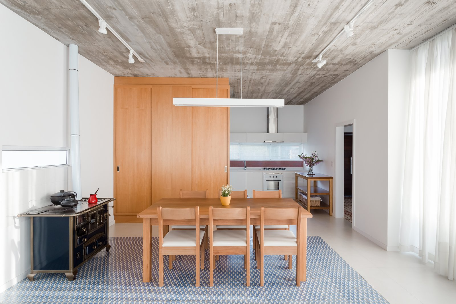 Tagged: Dining Room, Track Lighting, Table, Chair, and Ceramic Tile Floor.  View House by Barbara Becker