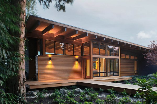 Modern home with shrubs, trees, grass, front yard, walkways, and living room. Entry Photo  of Hotchkiss Residence