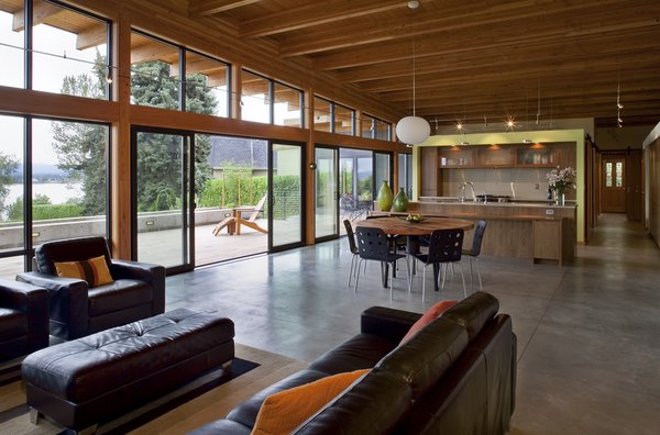 Modern home with concrete floor, track lighting, and kitchen. Interior Photo 3 of Hotchkiss Residence