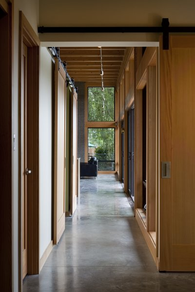 Modern home with hallway and concrete floor. Hallway Photo 4 of Hotchkiss Residence