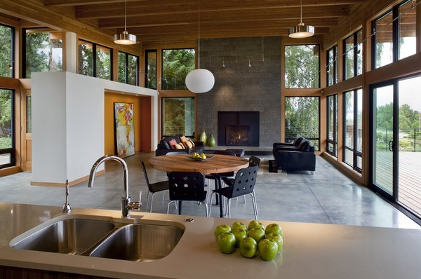 Modern home with kitchen, undermount sink, concrete floor, and ceiling lighting. Interior Photo 5 of Hotchkiss Residence