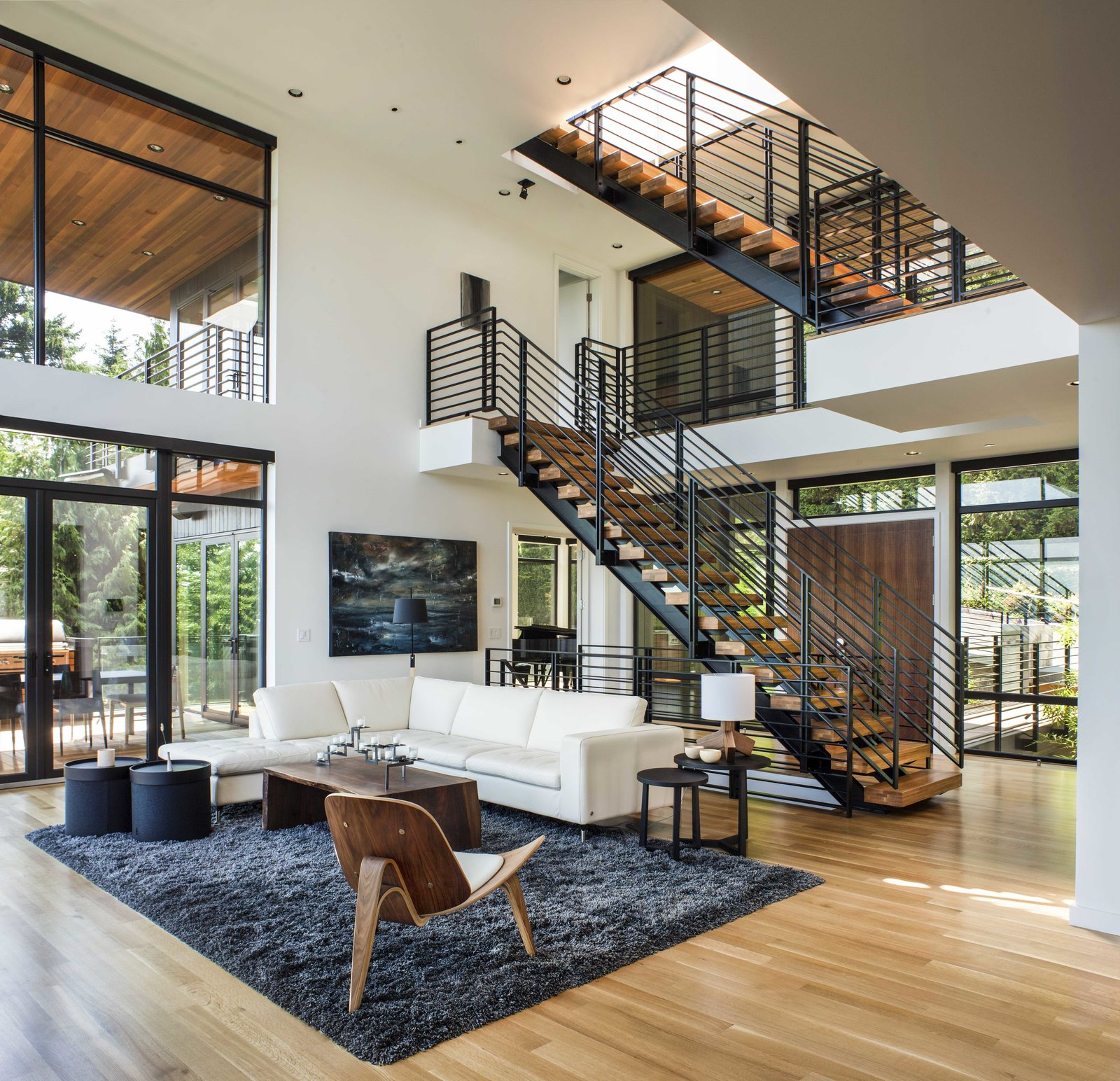 Interior Tagged: Living Room, Sofa, Ceiling Lighting, Sectional, Medium Hardwood Floor, and Chair.  Music Box Residence by Scott | Edwards Architecture