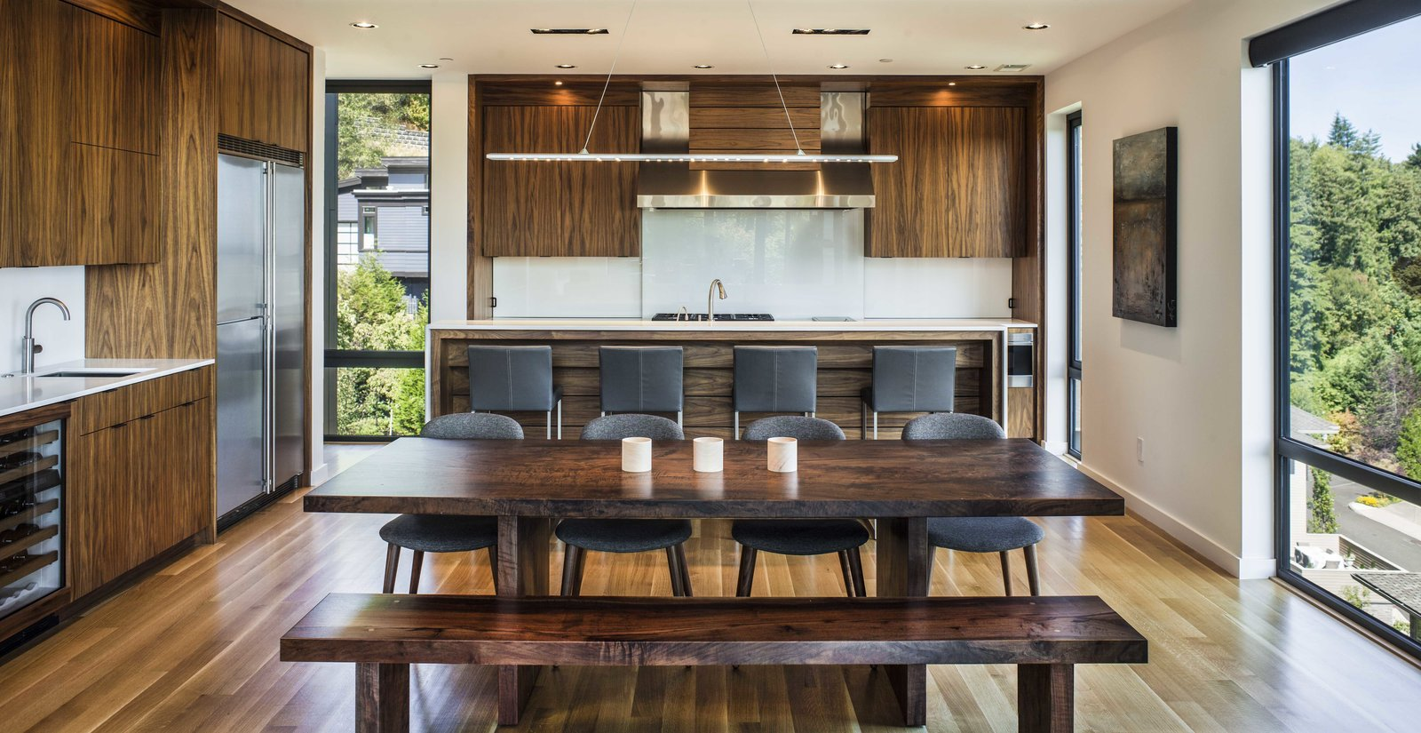 Kitchen Tagged: Kitchen, Wood Cabinet, Refrigerator, Medium Hardwood Floor, Ceiling Lighting, Pendant Lighting, Undermount Sink, and Range.  Music Box Residence by Scott | Edwards Architecture