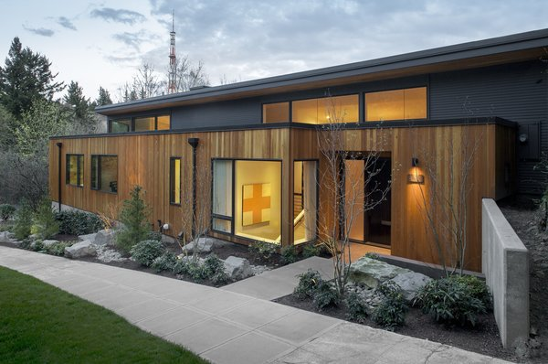 Modern home with outdoor, trees, shrubs, grass, front yard, walkways, and hardscapes. Entry Photo  of West Hills Remodel