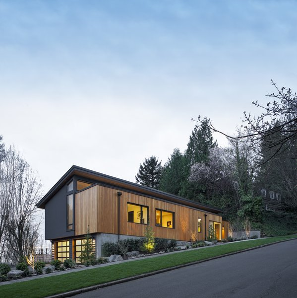 Modern home with outdoor, shrubs, grass, trees, hardscapes, and walkways. Front Photo 2 of West Hills Remodel