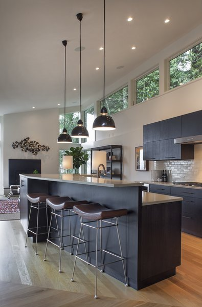 Modern home with kitchen, ceiling lighting, medium hardwood floor, wood cabinet, and pendant lighting. Kitchen Photo 4 of West Hills Remodel