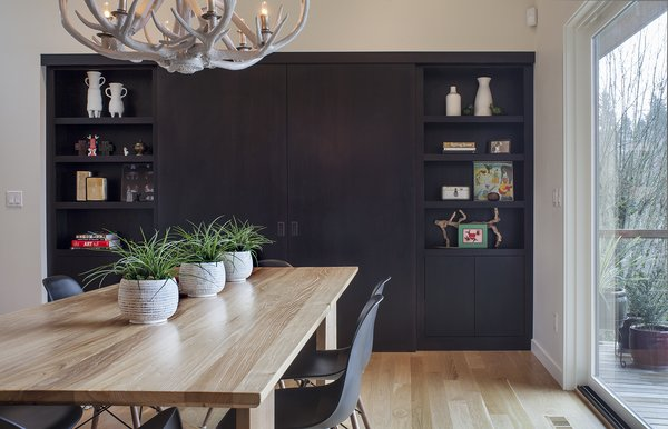 Modern home with chair, ceiling lighting, table, pendant lighting, medium hardwood floor, office, study, and craft room. Dining/Study Photo 7 of West Hills Remodel