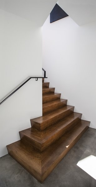 Modern home with staircase, wood tread, and metal railing. Stair Photo 6 of Canterbury Residence