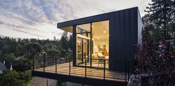 Modern home with outdoor, trees, shrubs, and grass. Deck Photo 7 of Canterbury Residence