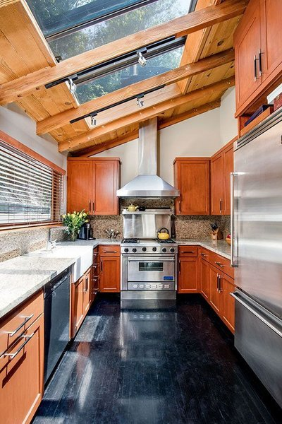 Modern home with kitchen, granite counter, wood cabinet, refrigerator, track lighting, dark hardwood floor, and dishwasher. Kitchen Photo 10 of Cedar Lodge on over a 1/2 Private Acre in Lower Nichols Canyon