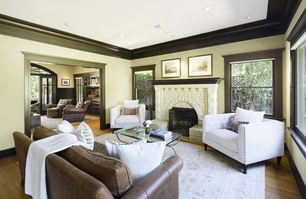 Modern home with living room, medium hardwood floor, and wood burning fireplace. John Viener House - Living Room  Photo 3 of John Viener Home