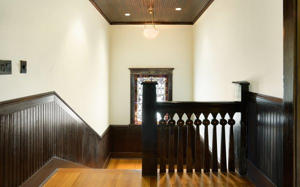 Modern home with staircase, wood tread, and wood railing. John Viener House - Stairway Photo 9 of John Viener Home