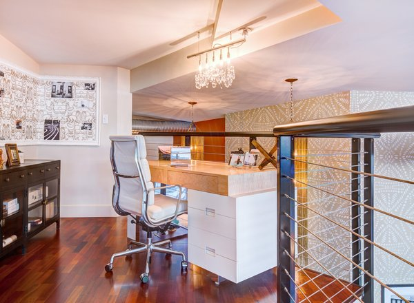 Modern home with office, desk, storage, chair, and medium hardwood floor. Photo 12 of Lofty Living