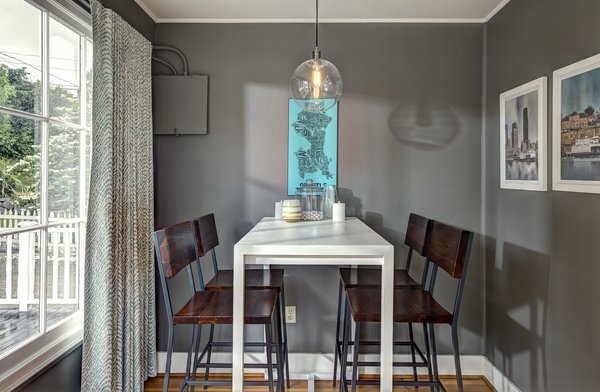 Modern home with dining room, table, chair, bar, stools, medium hardwood floor, ceiling lighting, and light hardwood floor. Photo 13 of Craftsman Cool