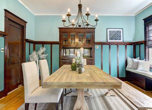 Modern home with dining room, table, chair, medium hardwood floor, ceiling lighting, carpet floor, and light hardwood floor. Photo 5 of Craftsman Cool