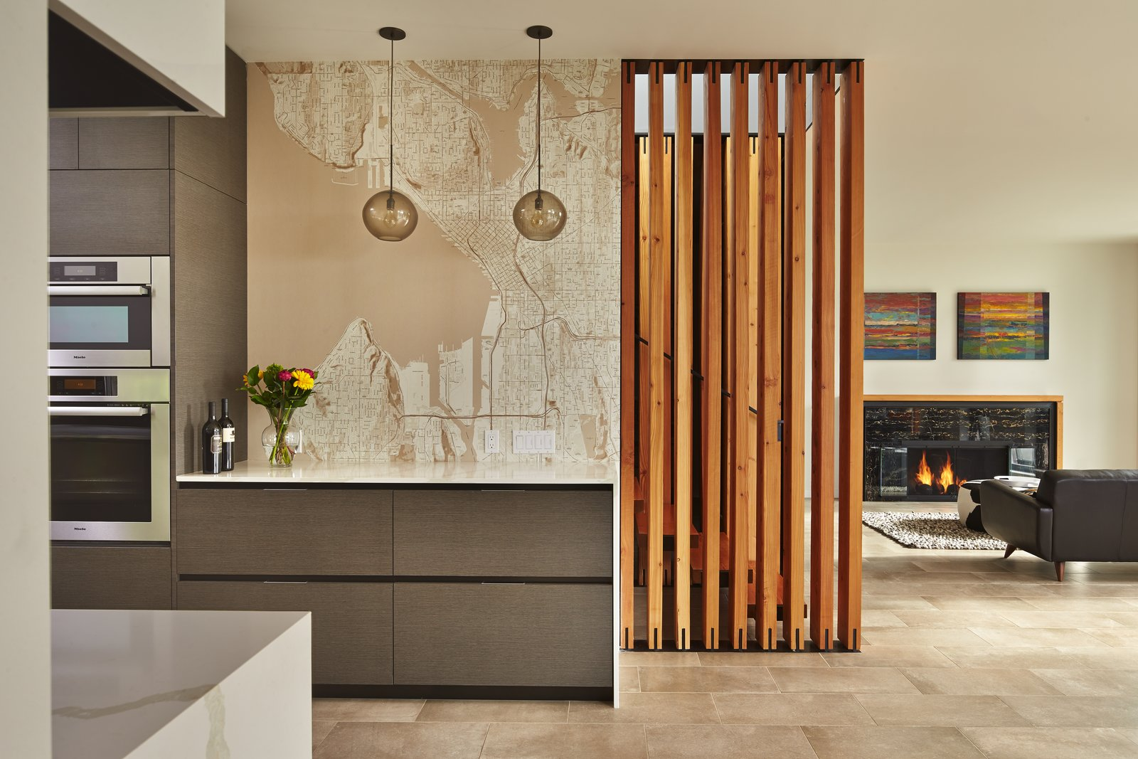 Tagged: Laminate Cabinet, Engineered Quartz Counter, Porcelain Tile Floor, Pendant Lighting, Wall Oven, Living Room, Accent Lighting, Gas Burning Fireplace, and Sofa. BLK_LAB by Patano Studio Architecure