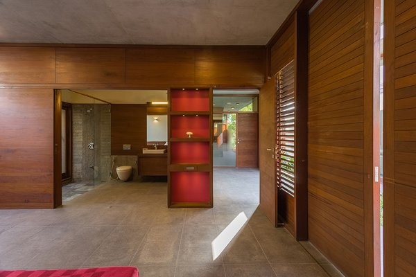 Modern home with bedroom, shelves, and ceiling lighting. Internal spaces. Photo 12 of The Open house