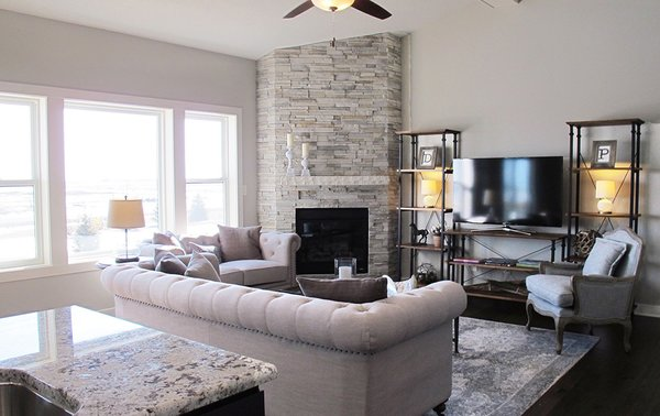 Modern home with living room, sofa, ceiling lighting, bookcase, dark hardwood floor, and corner fireplace. Photo 3 of Dynasty Partners Home