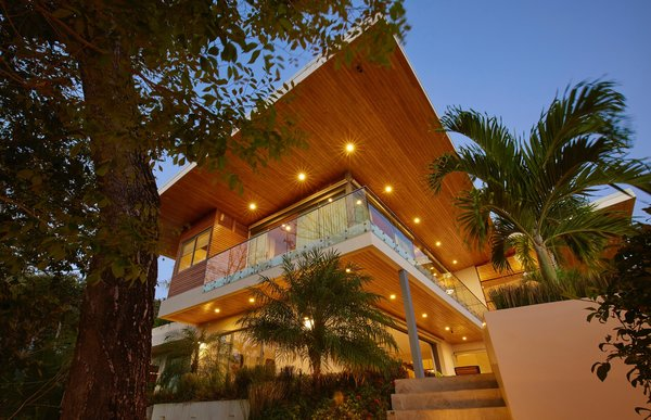 Modern home with outdoor, garden, trees, and landscape lighting. From below Photo 7 of Pacific Breeze house overlooking the Ocean