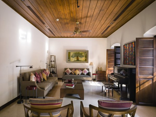Modern home with living room, sofa, chair, bench, end tables, coffee tables, storage, lamps, recessed lighting, console tables, terrazzo floor, and ceiling lighting. Duravit- Bathroom Faucets, Bathroom Sinks, Bathtub  & Shower  Hansgrohe- Plumbing  Bharat Floorings Group- Floor  Daikin- Air Conditioners  Imagination Lights- Lighting  Marble Center International- Floor  Moie- Furniture Photo 4 of VILLA RIBANDAR