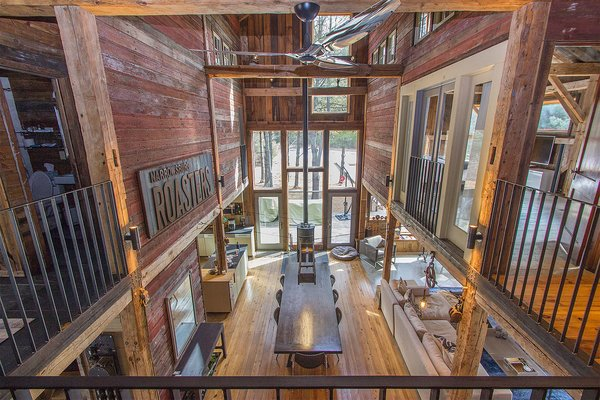 Modern home with dining room, floor lighting, chair, stools, ceiling lighting, wall lighting, pendant lighting, table lighting, and light hardwood floor. Photo 5 of Vintage Barn