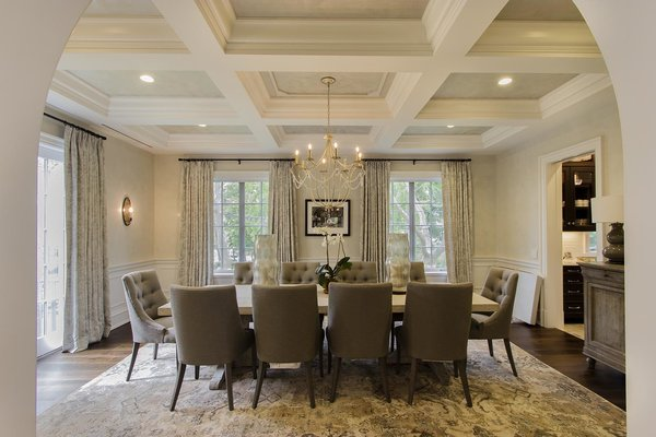 Modern home with dining room, chair, ceiling lighting, table, lamps, recessed lighting, and dark hardwood floor. Photo 6 of Bay Ridge Estate