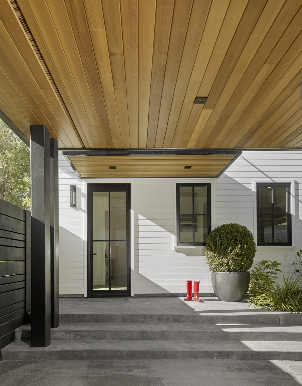 Cedar carport and side entry.  Red boots to boot. Tagged: Garage and Detached Garage.  Wine Country Cool by George Bevan