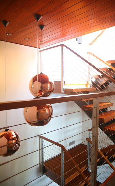 Modern home with staircase, wood tread, and metal railing. Photo 7 of Walloon Lake House