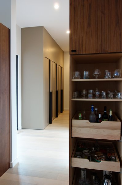 Modern home with kitchen, wood cabinet, light hardwood floor, and ceiling lighting. Photo 6 of Long House HS