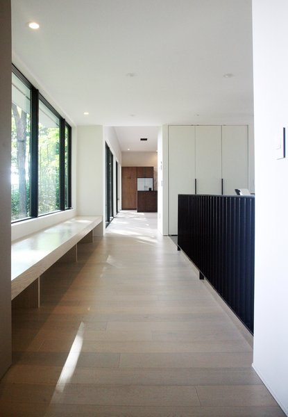Modern home with hallway and light hardwood floor. Photo 8 of Long House HS