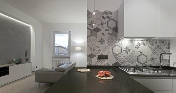 Modern home with kitchen, engineered quartz counter, ceramic tile backsplashe, light hardwood floor, ceramic tile floor, and pendant lighting. Photo 7 of CASA LC