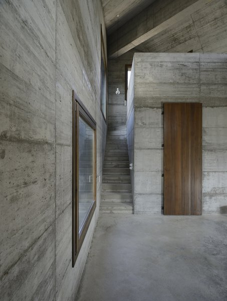 Modern home with living room, pendant lighting, and concrete floor. Photo 20 of HOUSE R