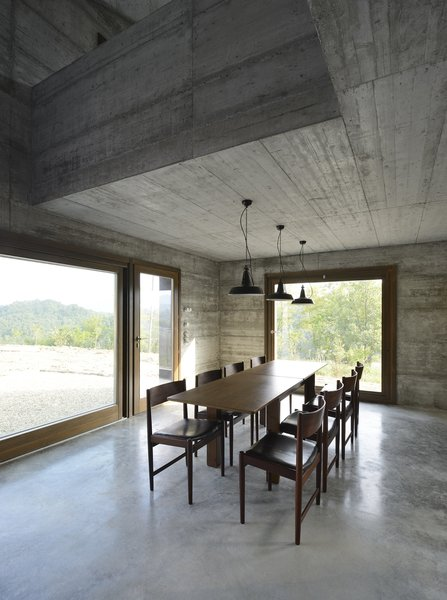 Modern home with dining room, table, ceiling lighting, chair, concrete floor, and pendant lighting. Photo 15 of HOUSE R