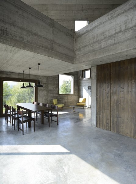Modern home with dining room, chair, ceiling lighting, pendant lighting, table, and concrete floor. Photo 16 of HOUSE R