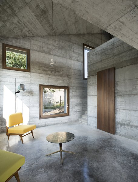 Modern home with living room, coffee tables, sofa, concrete floor, and pendant lighting. Photo 18 of HOUSE R