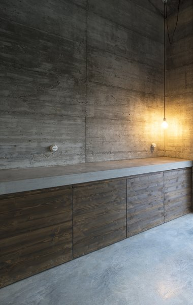 Modern home with kitchen, concrete counter, wood counter, concrete floor, concrete backsplashe, and pendant lighting. Photo 19 of HOUSE R