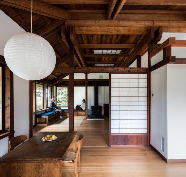 Modern home with dining room, table, light hardwood floor, chair, and pendant lighting. Photo 7 of Hinoki House