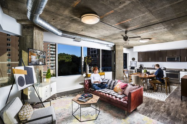 Modern home with living room. Huge windows, tall ceilings, plank floors and designer kitchens create an atmosphere of luxury with a modern, industrial aesthetic. Photo 2 of e-lofts Alexandria