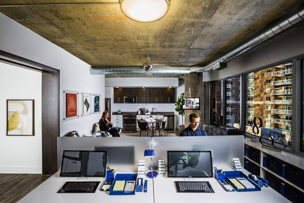 Modern home with office. Each loft has business-ready electrical and data service and fiber-optic backbone capability to ensure seamless functionality for business occupancy for up to 10 employees. Photo 5 of e-lofts Alexandria