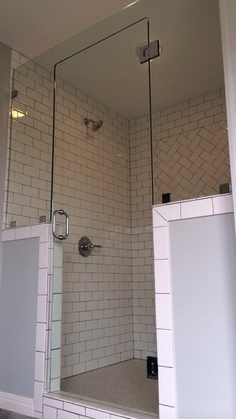 Modern home with bath room, ceiling lighting, enclosed shower, and subway tile wall. One piece sideline/transom frameless shower enclosure Photo  of Custom Frameless Shower Enclosure Projects