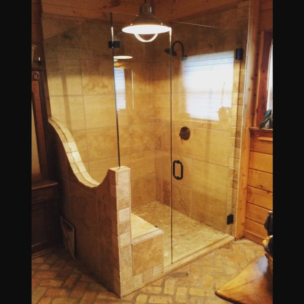 Modern home with bath room, brick floor, enclosed shower, corner shower, ceiling lighting, and stone tile wall. Incredible pattern cut frameless enclosure by Anderson Glass Photo 3 of Custom Frameless Shower Enclosure Projects