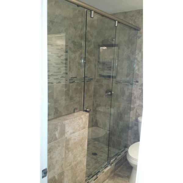 Modern home with bath room, ceramic tile floor, and enclosed shower. Sliding Shower Door with pony wall by Anderson Glass Photo 2 of Sliding Shower Doors
