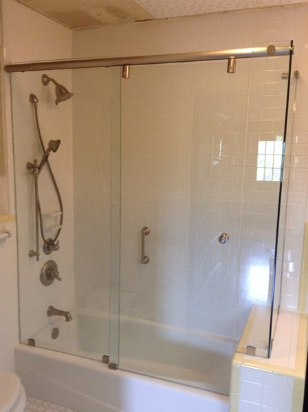Modern home with bath room, drop in tub, enclosed shower, corner shower, and subway tile wall. Corner Style Sliding Shower Door on a Tub by Anderson Glass Photo 5 of Sliding Shower Doors