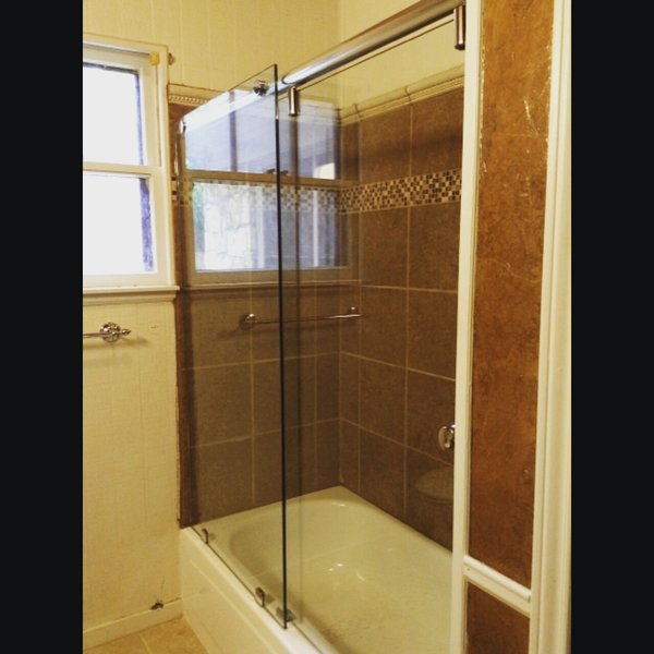 Modern home with bath room and enclosed shower. Hydroslide Series Sliding Shower Door by Anderson Glass Photo 6 of Sliding Shower Doors
