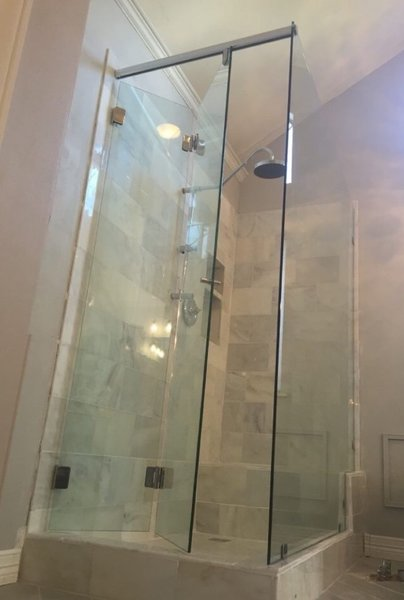 Modern home with bath room, corner shower, and enclosed shower. Bi-Fold Sliding Shower Door - Hydroslide Series by Anderson Glass Photo 7 of Sliding Shower Doors