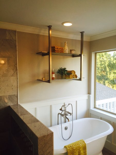 Modern home with bath room, freestanding tub, and enclosed shower. Stainless Steel Brackets with Glass Shelves by Anderson Glass Photo  of Shelving Units