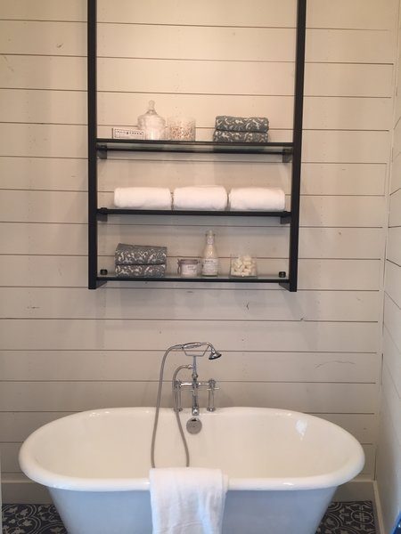 Modern home with bath room and freestanding tub. Over the tub open shelves by Anderson Glass Photo 6 of Shelving Units