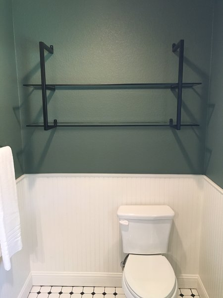 Modern home with bath room. Over the toilet shelving by Anderson Glass Photo 10 of Shelving Units
